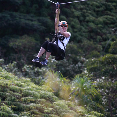 Diane hanging on a zip line