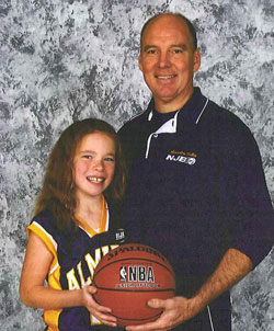 Don Hall and daughter with basketball