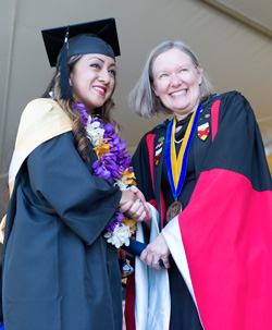 Judith Greig with student at graduation