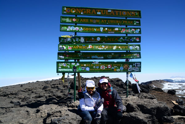 Kailesh at the summit of Mt. Kilimanjaro with his daughter