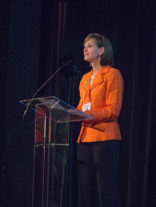 Melissa speaking at event