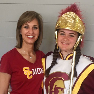 Melissa Diaz with her daughter in her marching band uniform
