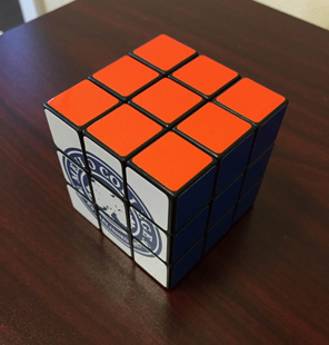 rubik's cube on desk