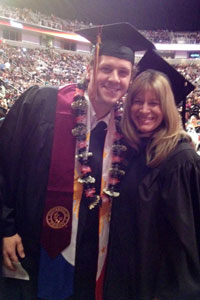 Stacy McAfee with student at graduation