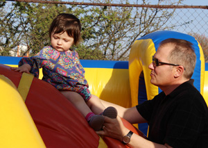 Terrence with daughter in bouncy castle