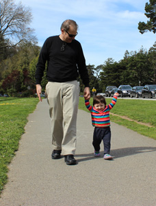 Terrence walking in park with daughter